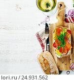 Купить «Sandwich with salmon, cucumber, cream cheese, dill and tomatoe», фото № 24931562, снято 19 января 2017 г. (c) Наталия Кленова / Фотобанк Лори