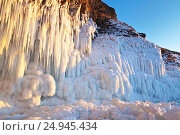 Купить «Байкал. Наплесковый лед и длинные сосульки на скалах острова Ольхон в закатном свете», фото № 24945434, снято 6 марта 2011 г. (c) Виктория Катьянова / Фотобанк Лори