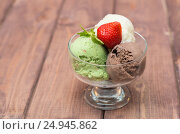 Colorful ice cream with strawberries on a wooden background. Стоковое фото, фотограф Андрей Черненко / Фотобанк Лори