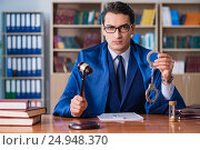 Купить «Handsome judge with gavel sitting in courtroom», фото № 24948370, снято 3 ноября 2016 г. (c) Elnur / Фотобанк Лори