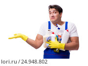 Купить «Man with cleaning agents isolated on white background», фото № 24948802, снято 31 октября 2016 г. (c) Elnur / Фотобанк Лори