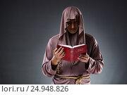 Купить «Monk in religious concept on gray background», фото № 24948826, снято 26 октября 2016 г. (c) Elnur / Фотобанк Лори