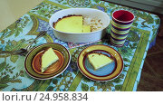 Купить «Cooking curd casserole. Table served for breakfast. Two plates with slices of baked pudding, coloured cup for tea. HD», видеоролик № 24958834, снято 12 декабря 2016 г. (c) ActionStore / Фотобанк Лори