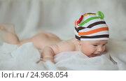 Купить «Funny four month old baby lying on his stomach and smiling. Slow motion shooting.», видеоролик № 24968054, снято 20 января 2017 г. (c) Mikhail Davidovich / Фотобанк Лори