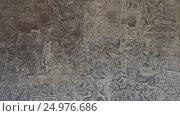 Купить «Bas-relief stone carving in Angkor Wat, Cambodia», видеоролик № 24976686, снято 7 декабря 2016 г. (c) Михаил Коханчиков / Фотобанк Лори
