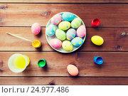Купить «close up of colored easter eggs on plate», фото № 24977486, снято 27 января 2016 г. (c) Syda Productions / Фотобанк Лори