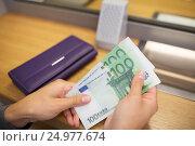 Купить «hands with money at bank or currency exchanger», фото № 24977674, снято 8 сентября 2016 г. (c) Syda Productions / Фотобанк Лори