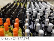 Купить «close up of bottles at liquor store», фото № 24977774, снято 2 ноября 2016 г. (c) Syda Productions / Фотобанк Лори