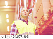 Купить «man in reflective safety vest at warehouse», фото № 24977898, снято 9 декабря 2015 г. (c) Syda Productions / Фотобанк Лори