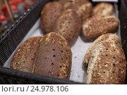 Купить «close up of rye bread at bakery or grocery store», фото № 24978106, снято 2 ноября 2016 г. (c) Syda Productions / Фотобанк Лори