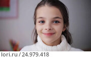 Купить «happy smiling beautiful girl in sweater at home», видеоролик № 24979418, снято 10 ноября 2016 г. (c) Syda Productions / Фотобанк Лори