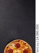 Купить «Delicious italian pizza served on grey background», фото № 24980050, снято 30 сентября 2016 г. (c) Wavebreak Media / Фотобанк Лори