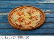 Delicious italian pizza served on pizza tray, фото № 24980430, снято 30 сентября 2016 г. (c) Wavebreak Media / Фотобанк Лори