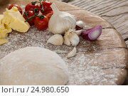 Купить «Pizza dough and flour with ingredient», фото № 24980650, снято 30 сентября 2016 г. (c) Wavebreak Media / Фотобанк Лори