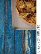 Купить «Delicious pizza in pizza box», фото № 24980710, снято 30 сентября 2016 г. (c) Wavebreak Media / Фотобанк Лори