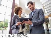 Купить «Business executives discussing over digital tablet», фото № 24980762, снято 3 ноября 2016 г. (c) Wavebreak Media / Фотобанк Лори