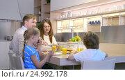 Купить «Family with children at dinner», видеоролик № 24992178, снято 18 января 2020 г. (c) Raev Denis / Фотобанк Лори