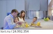 Купить «Family praying before dinner», видеоролик № 24992354, снято 6 декабря 2019 г. (c) Raev Denis / Фотобанк Лори
