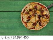 Купить «Delicious italian pizza served on pizza peel», фото № 24994450, снято 30 сентября 2016 г. (c) Wavebreak Media / Фотобанк Лори