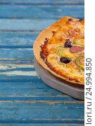Купить «Delicious italian pizza served on pizza tray», фото № 24994850, снято 30 сентября 2016 г. (c) Wavebreak Media / Фотобанк Лори