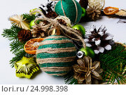 Купить «Christmas wreath with homemade jute twine ornaments», фото № 24998398, снято 27 ноября 2016 г. (c) TasiPas / Фотобанк Лори