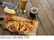 Купить «Italian pizza served on a chopping board with a beer mug and glass», фото № 24999710, снято 30 сентября 2016 г. (c) Wavebreak Media / Фотобанк Лори