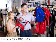 Купить «Assistant helping customer shopping seductive frillies», фото № 25001342, снято 23 апреля 2019 г. (c) Яков Филимонов / Фотобанк Лори