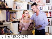 Купить «adult couple buying sex toys in shop», фото № 25001370, снято 23 марта 2019 г. (c) Яков Филимонов / Фотобанк Лори