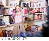 adult girl choosing toys in sex shop. Стоковое фото, фотограф Яков Филимонов / Фотобанк Лори