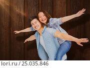 Купить «Composite image of portrait of happy couple with arms outstretched», фото № 25035846, снято 25 марта 2019 г. (c) Wavebreak Media / Фотобанк Лори