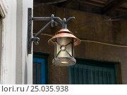 Купить «Old lamp on the street», фото № 25035938, снято 10 сентября 2016 г. (c) Elena Odareeva / Фотобанк Лори