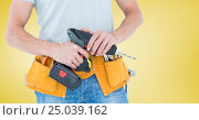 Mid-section of handy man with tool belt and drill. Стоковое фото, агентство Wavebreak Media / Фотобанк Лори