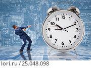 Купить «Businessman pulling clock in time management concept», фото № 25048098, снято 30 мая 2020 г. (c) Elnur / Фотобанк Лори