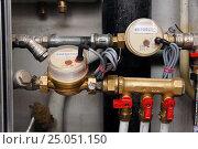 Купить «Установленный комплект счетчиков расхода воды», фото № 25051150, снято 2 декабря 2012 г. (c) Orion34 / Фотобанк Лори