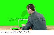 Купить «Rear view of businessman using a laptop and digital tablet», видеоролик № 25051182, снято 10 апреля 2020 г. (c) Wavebreak Media / Фотобанк Лори