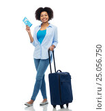 Купить «happy woman with airplane ticket and travel bag», фото № 25056750, снято 17 декабря 2016 г. (c) Syda Productions / Фотобанк Лори
