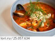 Купить «close up of seafood soup with fish and mussels», фото № 25057634, снято 16 января 2017 г. (c) Syda Productions / Фотобанк Лори