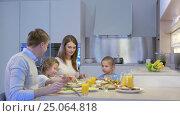 Купить «Family dinner in kitchen», видеоролик № 25064818, снято 19 сентября 2019 г. (c) Raev Denis / Фотобанк Лори