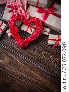 Купить «Red heart on wooden», фото № 25072090, снято 3 февраля 2017 г. (c) Типляшина Евгения / Фотобанк Лори
