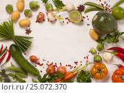 Купить «Frame of organic vegetables on white», фото № 25072370, снято 31 января 2017 г. (c) Наталия Кленова / Фотобанк Лори