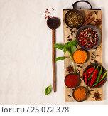 Купить «Different spices in bowls on table», фото № 25072378, снято 31 января 2017 г. (c) Наталия Кленова / Фотобанк Лори