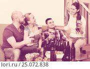 Купить «Two couples having fun at house party», фото № 25072838, снято 17 февраля 2019 г. (c) Яков Филимонов / Фотобанк Лори
