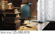 Купить «Square computer monitor on table with pile of books in old archive interior», видеоролик № 25080810, снято 11 октября 2016 г. (c) Александр Багно / Фотобанк Лори
