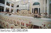 Tracking shot interior empty organ hall. Music stands and instruments on scene. Стоковое видео, видеограф Александр Багно / Фотобанк Лори