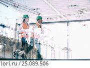 Купить «Composite image of colleagues running on building construction site», фото № 25089506, снято 26 февраля 2020 г. (c) Wavebreak Media / Фотобанк Лори