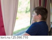 Купить «The boy looks out the window on train», фото № 25090710, снято 1 июля 2014 г. (c) Володина Ольга / Фотобанк Лори