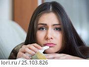 Купить «Young sad girl is melancholy», фото № 25103826, снято 20 февраля 2020 г. (c) Яков Филимонов / Фотобанк Лори