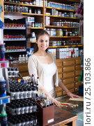 Купить «Seller to help at cash desk», фото № 25103866, снято 4 августа 2020 г. (c) Яков Филимонов / Фотобанк Лори