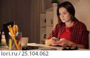 Купить «student woman with laptop and smartphone at home», видеоролик № 25104062, снято 16 декабря 2016 г. (c) Syda Productions / Фотобанк Лори