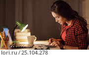 Купить «student girl with notebook and calculator at home», видеоролик № 25104278, снято 31 января 2017 г. (c) Syda Productions / Фотобанк Лори